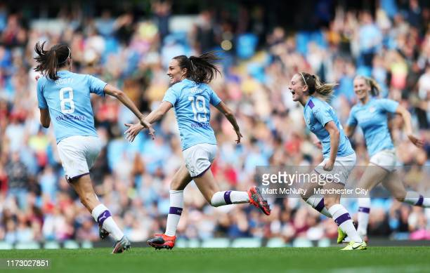 Caroline Weir of Manchester City celebrates with teammates after scoring her teams first goal during the Barclays FA Women's Super League match...