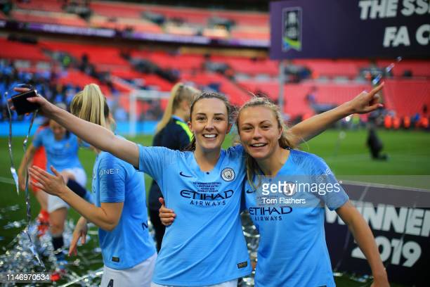 Caroline Weir of Manchester City Women and Claire Emslie of Manchester City Women celebrate following their sides victory in the Women's FA Cup Final...