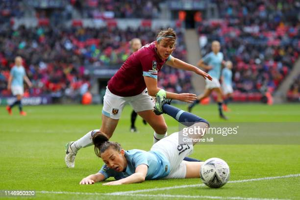 Caroline Weir of Manchester City Women is challenged by Erin Simon of West Ham United Ladies during the Women's FA Cup Final match between Manchester...