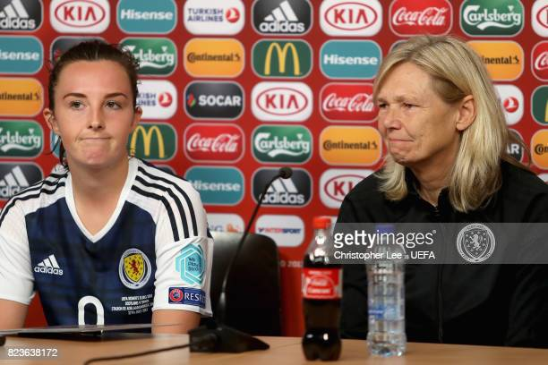 Caroline Weir of Scotland and Anna Signeul head coach of Scotland speak to the media during a press confrence after the Group D match between...