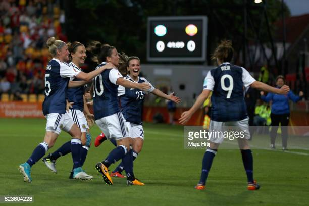 Caroline Weir of Scotland celebrates scoring her sides first goal with her Scotland team mates during the Group D match between Scotland and Spain...