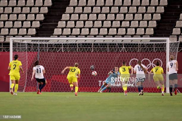 Caroline Weir of Team Great Britain takes a penalty which is saved by Teagan Micah of Team Australia during the Women's Quarter Final match between...
