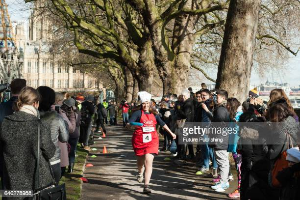 Caroline Wheeler of Sunday Express competes at the 20th Parliamentary Pancake Race on Shrove Tuesday also known as Pancake Day or Fat Tuesday in...