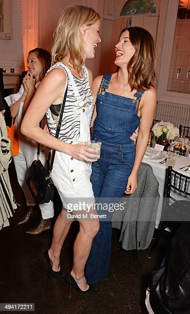 Caroline Winberg and Hanneli Mustaparta attend the FRAME Denim dinner hosted by Hanneli Mustaparta at Il Bottaccio on May 28 2014 in London England