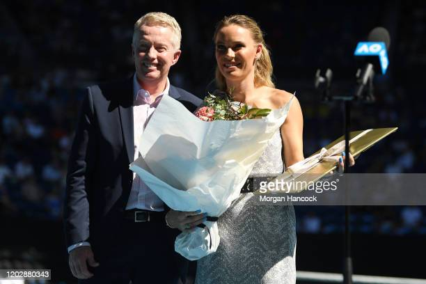 Caroline Wozniacki and Craig Tilley pose during the women's day ceremony on Rod Laver Arena on day eleven of the 2020 Australian Open at Melbourne...