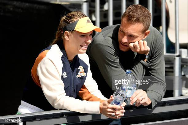 Caroline Wozniacki and husband David Lee looks on during day one of the 2020 ASB Classic at ASB Tennis Centre on January 06, 2020 in Auckland, New...