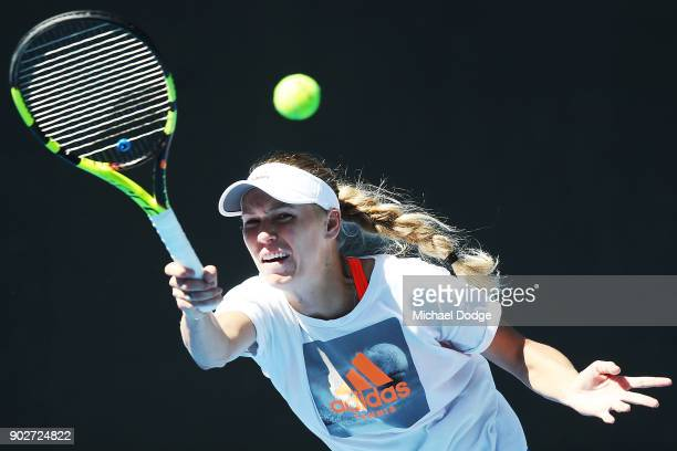 Caroline Wozniacki from Denmark hits a forehand during a practice session ahead of the 2018 Australian Open at Melbourne Park on January 9 2018 in...