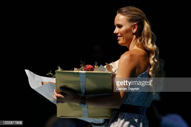 Caroline Wozniacki is presented with flowers during the women's day ceremony on Rod Laver Arena on day eleven of the 2020 Australian Open at...