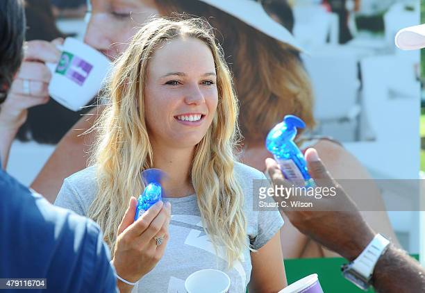 Caroline Wozniacki keeps cool before serving coffee to the queue at Wimbledon on July 1 2015 in London England