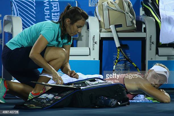 Caroline Wozniacki of Denmark accepts the bandage treatment during the match against Eugenie Bouchard of Canada on day six of 2014 Dongfeng Motor...