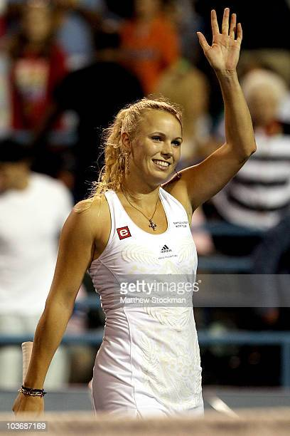 Caroline Wozniacki of Denmark acknowledges the crowd after her win over Elena Dementieva of Russia during the semifinals of the Pilot Pen tennis...