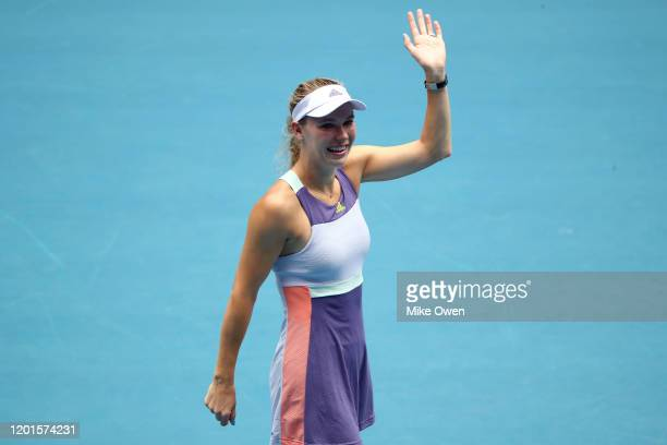 Caroline Wozniacki of Denmark acknowledges the crowd after losing her Women's Singles third round match against Ons Jabeur of Tunisia on day five of...