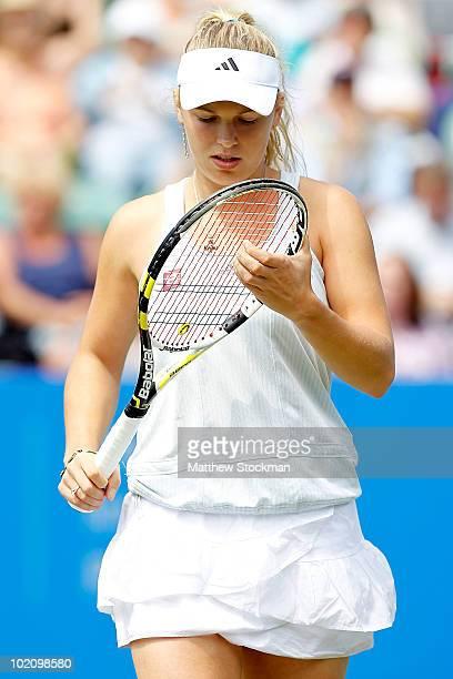 Caroline Wozniacki of Denmark adjusts her racquet between points against Aravane Rezai of France druing the AEGON International at Devonshire Park on...