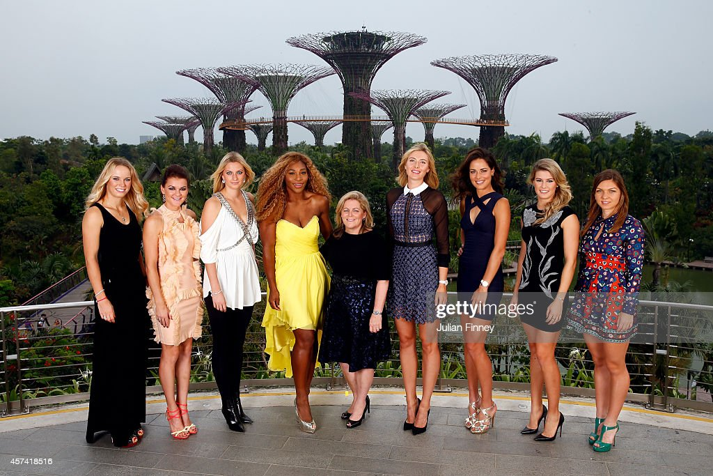Caroline Wozniacki of Denmark, Agnieszka Radwanska of Poland, Petra Kvitova of Czech Republic, Serena Williams of USA, Stacey Allaster Chairman and CEO of the WTA, Maria Sharapova of Russia, Ana Ivanovic of Serbia, Eugenie Bouchard of Canada and Simona Halep of Romania pose for a photo at the Gardens by the Bay during previews for the WTA Finals at Singapore Sports Hub on October 18, 2014 in Singapore.
