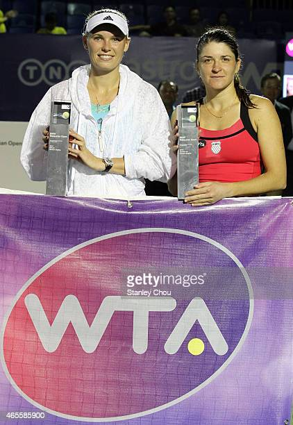 Caroline Wozniacki of Denmark and Alexandra Dulgheru of Romania poses with their Trophies after the Singles Final of the BMW Malaysian Open at the...