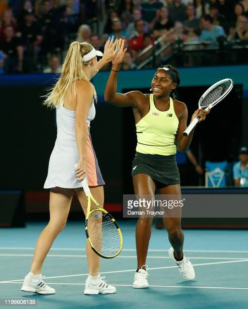 Caroline Wozniacki of Denmark and Coco Gauff of the USA high five during the Rally for Relief Bushfire Appeal event at Rod Laver Arena on January 15...
