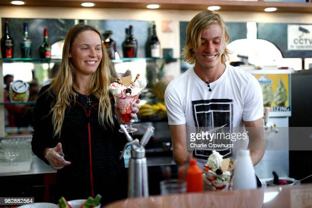 Caroline Wozniacki of Denmark and Denis Shapovalov of Canada make Sunday ice creams at a local parlour during Day Three of the Nature Valley...