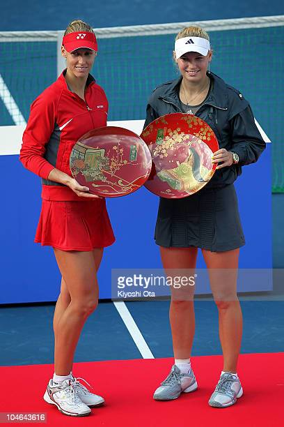 Caroline Wozniacki of Denmark and Elena Dementieva of Russia pose with trophies during the award ceremony after the Women's Singles final match on...