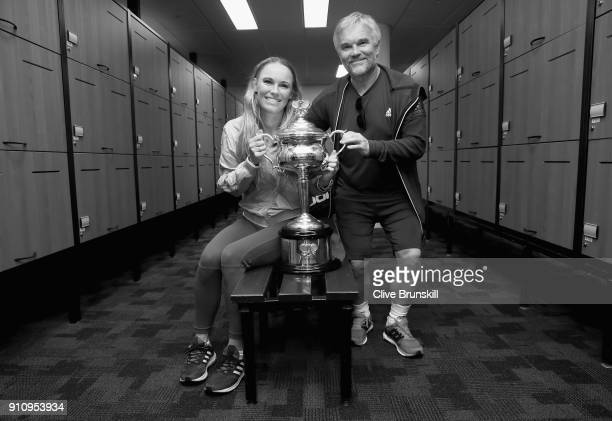 Caroline Wozniacki of Denmark and father Piotr pose with the Daphne Akhurst Trophy in the locker room after winning the Women's Singles Final against...