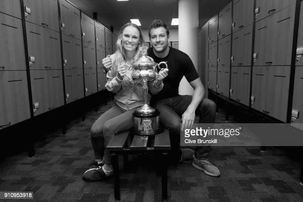 Caroline Wozniacki of Denmark and fiance David Lee pose with the Daphne Akhurst Trophy in the lockerroom after winning the Women's Singles Final...