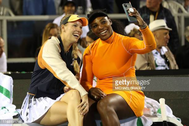 Caroline Wozniacki of Denmark and Serena Williams of the US take a selfie after losing in their match against Asia Muhammad and Taylor Townsend of...