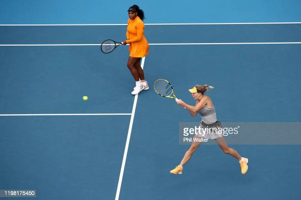 Caroline Wozniacki of Denmark and Serena Williams of the USA in action during their doubles match against Carolone Dolehide of the USA and Johanna...