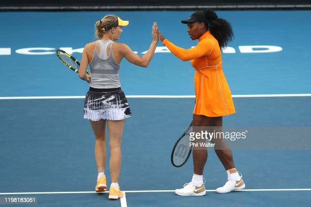 Caroline Wozniacki of Denmark and Serena Williams of the USA in action during their doubles match against Caroline Dolehide of the USA and Johanna...