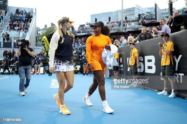 Caroline Wozniacki of Denmark and Serena Williams of the USA leave the court following their doubles match against Caroline Dolehide of the USA and...