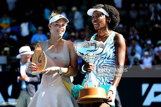 Caroline Wozniacki of Denmark and Venus Williams of USA talk to each other after their singles final during day six of the 2015 ASB Classic at ASB...