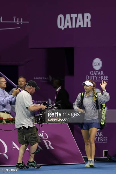 Caroline Wozniacki of Denmark arrives on the court ahead of her match with Angelique Kerber of Germany in their singles match during the quarterfinal...
