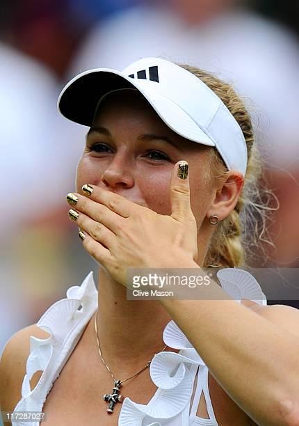 Caroline Wozniacki of Denmark blows a kiss to the crowd after winning her third round match against Jarmila Gajdosova of Australia on Day Six of the...