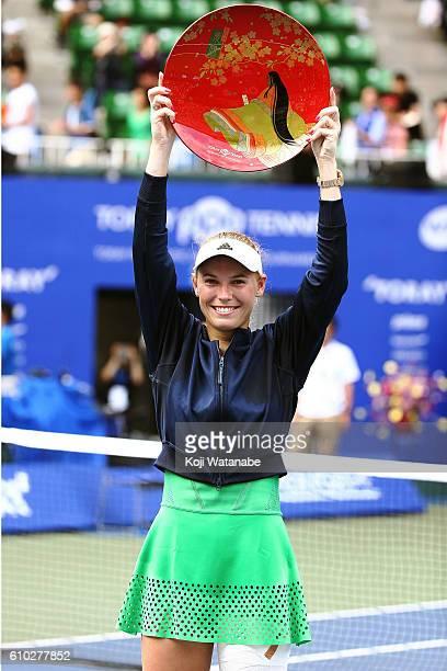 Caroline Wozniacki of Denmark celebrate the winner Naomi Osaka of Japan during women's singles Final match day 7 of the Toray Pan Pacific Open at...