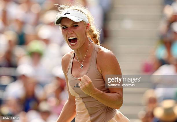 Caroline Wozniacki of Denmark celebrates a point against Shuai Peng of China during their women's singles semifinal match on Day Twelve of the 2014...