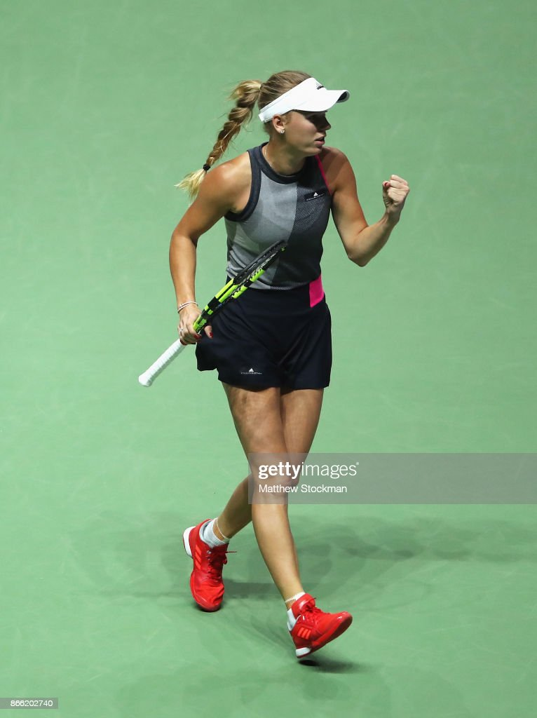 Caroline Wozniacki of Denmark celebrates a point in her singles match against Simona Halep of Romania during day 4 of the BNP Paribas WTA Finals Singapore presented by SC Global at Singapore Sports Hub on October 25, 2017 in Singapore.