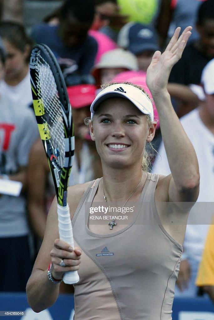 Caroline Wozniacki of Denmark celebrates after defeating Aliaksandra Sasnovich of Belarus during the 2014 US Open women's singles match at the USTA Billie Jean King National Tennis Center August 27, 2014 in New York.AFP PHOTO/Kena Betancur