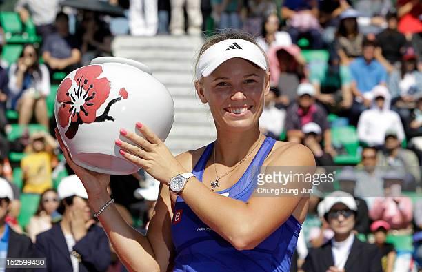 Caroline Wozniacki of Denmark celebrates after defeating Kaia Kanepi of Estonia to win the final on day six of the KDB Korea Open at Olympic Park...