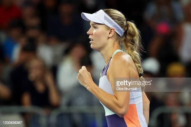 Caroline Wozniacki of Denmark celebrates after winning match point in her Women's Singles first round match against Kristie Ahn of the United States...