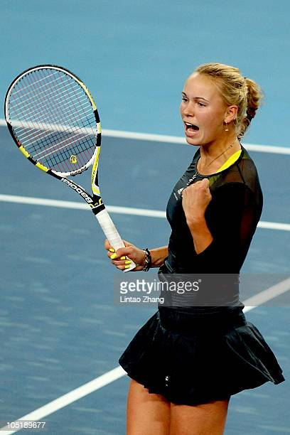 Caroline Wozniacki of Denmark celebrates breaking Vera Zvonareva of Russia during the final on day eleven of the 2010 China Open at the National...