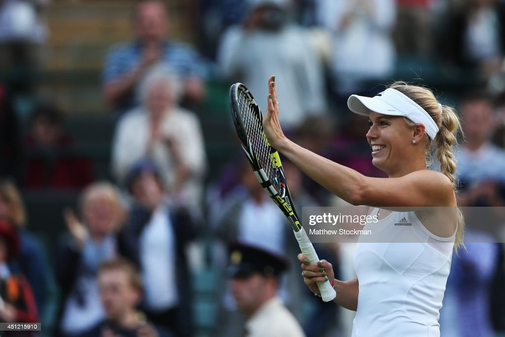 Caroline Wozniacki of Denmark celebrates during her Ladies' Singles second round match against Naomi Broady of Great Britain on day three of the Wimbledon Lawn Tennis Championships at the All England Lawn Tennis and Croquet Club at Wimbledon on June 25, 2014 in London, England.