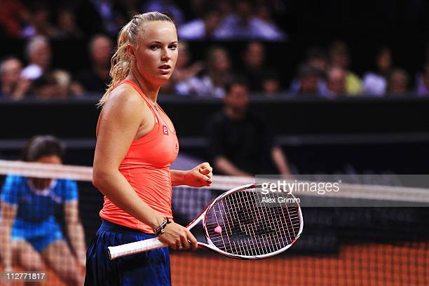 Caroline Wozniacki of Denmark celebrates during her Quarter Final match against Andrea Petkovic of Germany at the Porsche Tennis Grand Prix at...