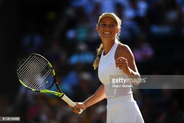 Caroline Wozniacki of Denmark celebrates during the Ladies Singles third round match against Anett Kontaveit of Estonia on day six of the Wimbledon...