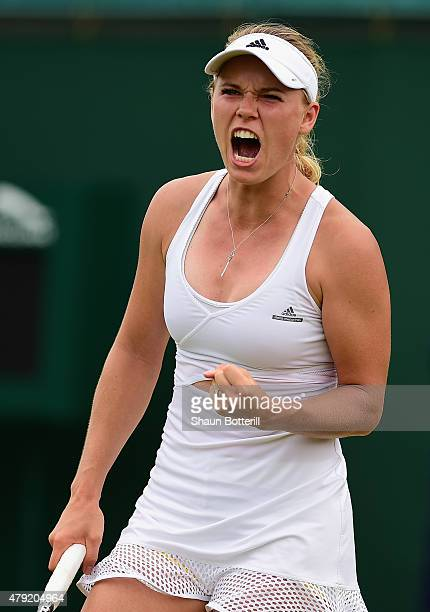 Caroline Wozniacki of Denmark celebrates in her match against Denisa Allertova of Czech Republic during their Women's Singles Second Round match...