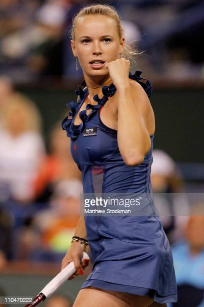 Caroline Wozniacki of Denmark celebrates match point against Maria Sharapova of Russia during the semifinals of the BNP Paribas Open at the Indian...