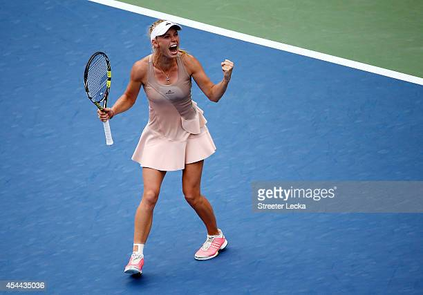 Caroline Wozniacki of Denmark celebrates match point against Maria Sharapova of Russia after winning their women's singles fourth round match on Day...