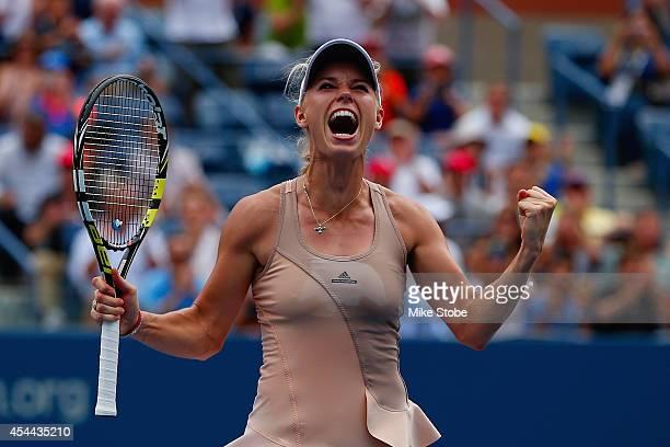 Caroline Wozniacki of Denmark celebrates match point against Maria Sharapova of Russia after winning their women's singles fourth round match on Day...