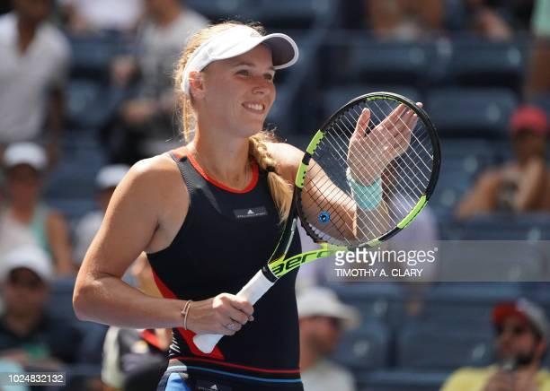 TOPSHOT Caroline Wozniacki of Denmark celebrates match point against Samantha Stosur of Australia during their Day 2 2018 US Open Women's Singles...