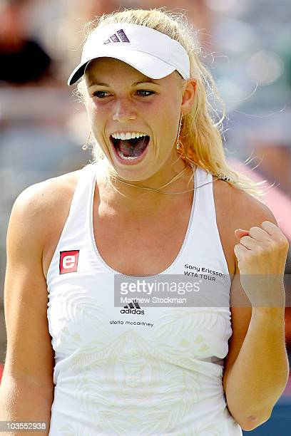 Caroline Wozniacki of Denmark celebrates match point against Vera Zvonareva of Russia during the final of the Rogers Cup at Stade Uniprix on August...