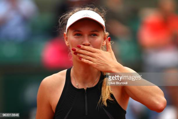 Caroline Wozniacki of Denmark celebrates victory following the ladies singles first round match against Danielle Collins of The United States during...
