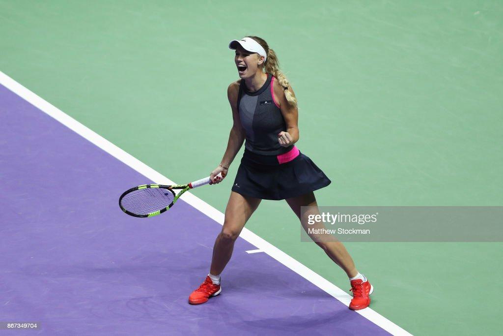 Caroline Wozniacki of Denmark celebrates victory in her singles semi final match against Karolina Pliskova of Czech Republic during day 7 of the BNP Paribas WTA Finals Singapore presented by SC Global at Singapore Sports Hub on October 28, 2017 in Singapore.
