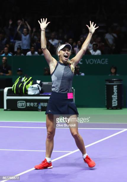 Caroline Wozniacki of Denmark celebrates victory in the Singles Final against Venus Williams of the United States during day 8 of the BNP Paribas WTA...
